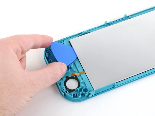 Continue sliding the opening pick along the left edge of the screen to slice the adhesive.