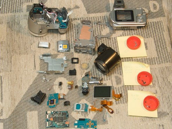 That's it. One Sony DSC-H2 in parts. Thanks for reading.