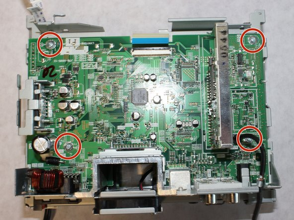 Remove the four 5mm screws from the corners of the circuit board using a Phillips #1 screwdriver