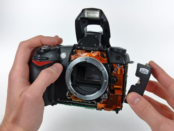 Remove the port cover from the D70.