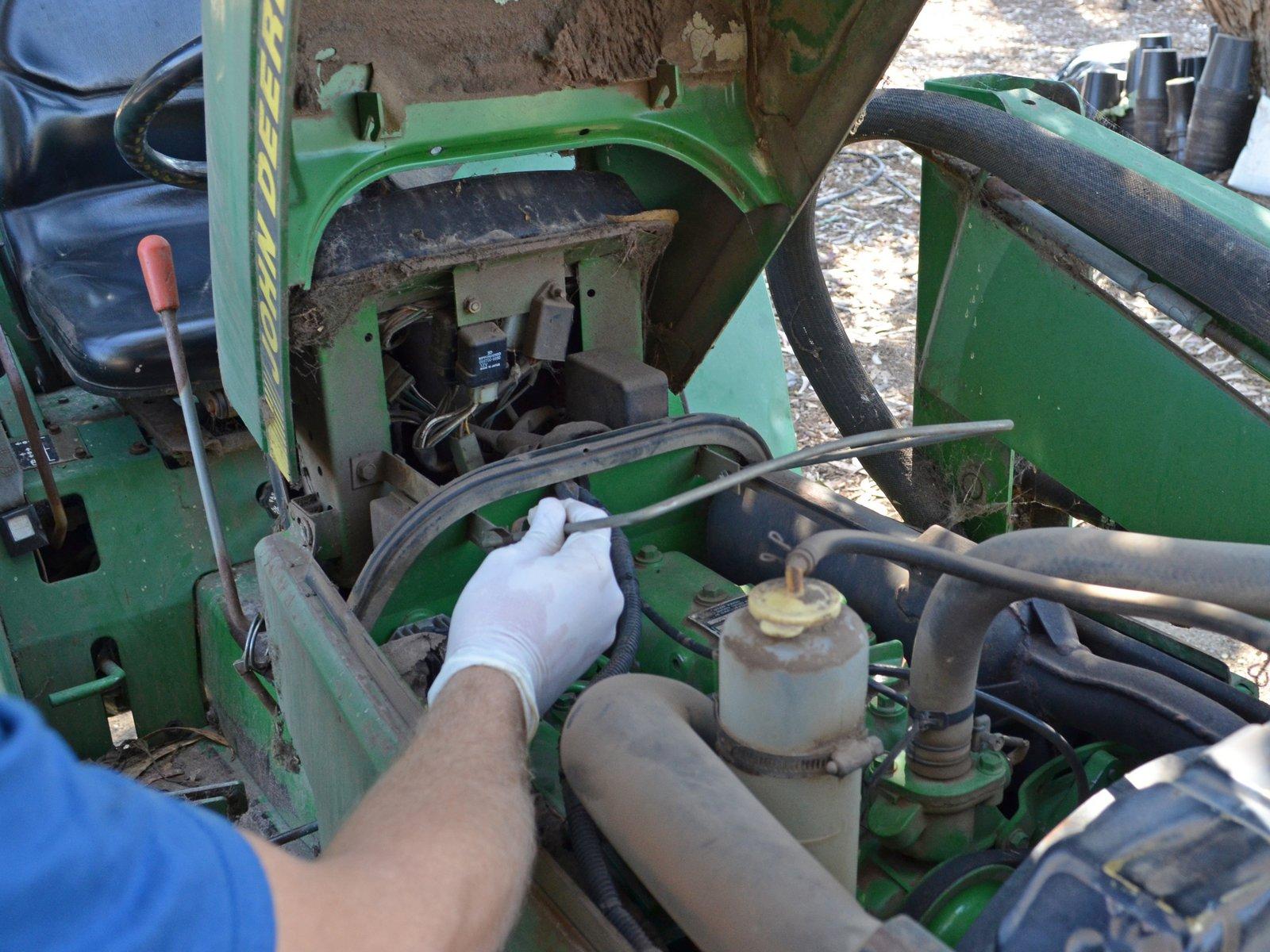 John Deere tractor oil change.
