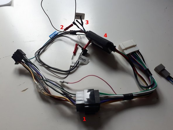 At (1), connect the stereo supplied power cable with the installation kit supplied adaptor cable.