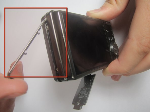Remove the chrome side cover from the body of the camera.