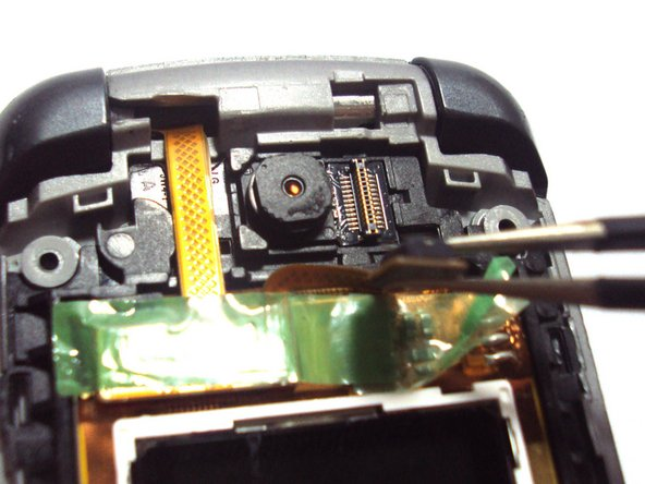 Use the tweezers to lift up the detached flex cable from the camera and then use your finger to hold it back.
