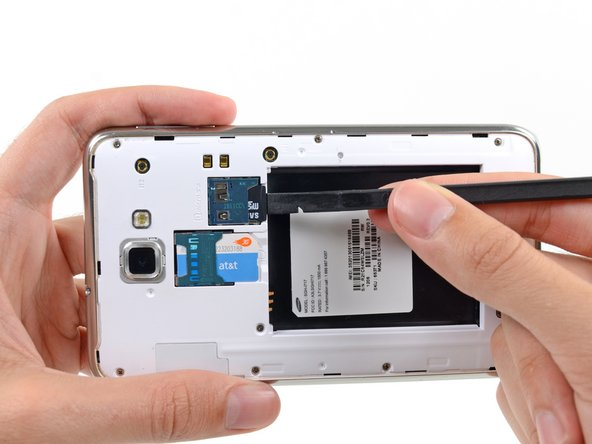 Use the flat end of a spudger, or your fingernail, to press the microSD card slightly deeper into its slot until you hear a click.