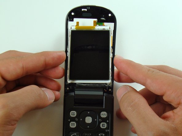 The LCD screen and circuit board should now be partly detached from the frame.