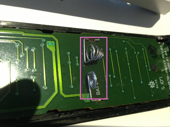 When placing rear cover back onto the assembled top cover make sure you correctly align the battery terminals with the slots in the cover