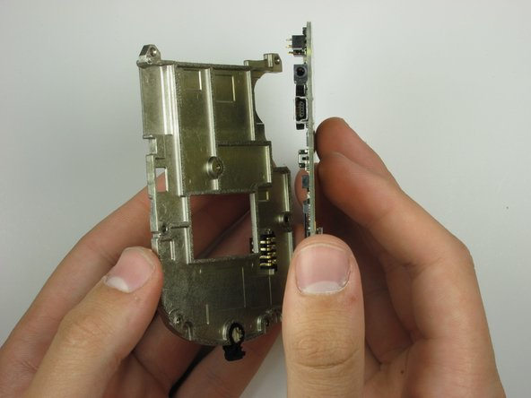 Separate the logic board mounting plate from the logic board by lifting with minimal force.