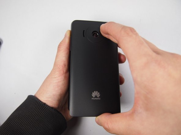 Remove the rear cover on the back by pulling up on the gap located at the bottom of the phone.