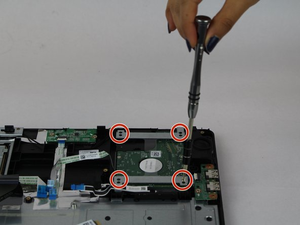 Remove the four 3mm Phillips #0 screws from the hard drive.