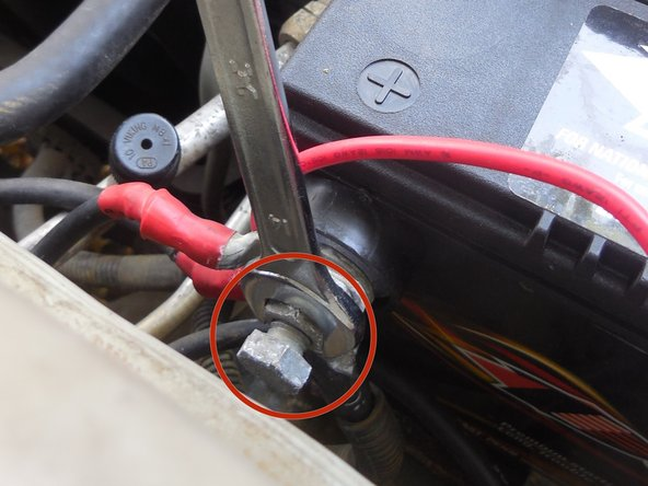Now with your 15mm wrench remove the positive terminal bolt, the same way you removed the negative terminal bolt.