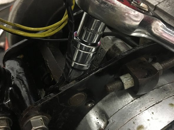 Remove the two barrel bolts from the gearbox retaining bands.