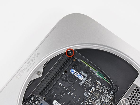 Remove the single 3.5 mm T6 Torx screw securing the cowling to the heat sink.