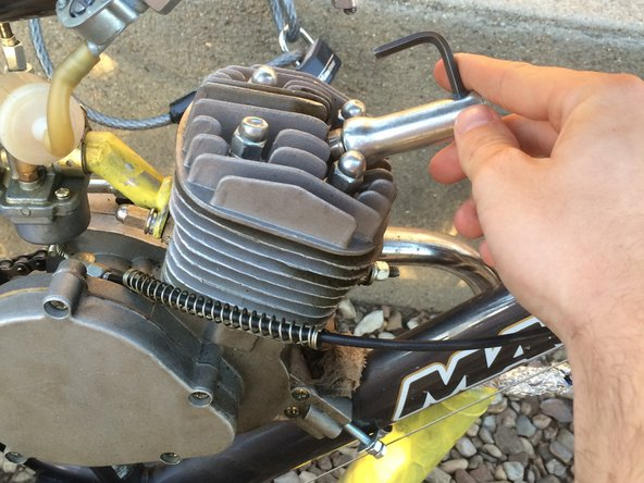 Place the spark plug tool on the spark plug and twist it counter clockwise to loosen it.