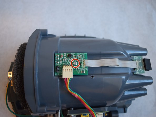 Remove the rainbow ribbon cable using  a plastic opening tool.