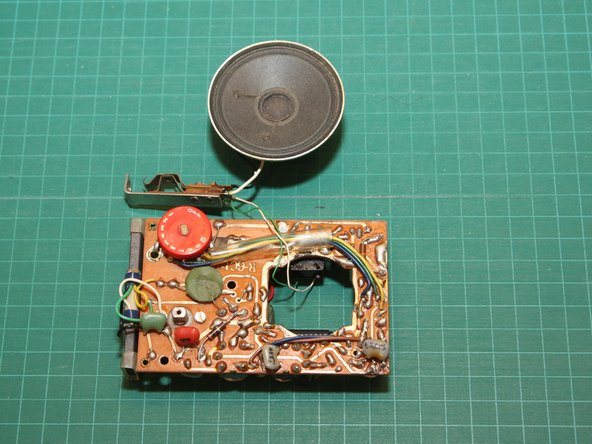 Here's the circuit board, earphone jack and speaker after they've been removed from the case.