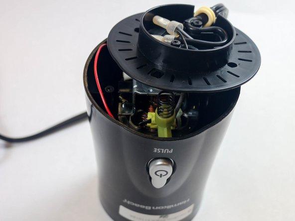 Unhinge the plastic motor platform from the blender.