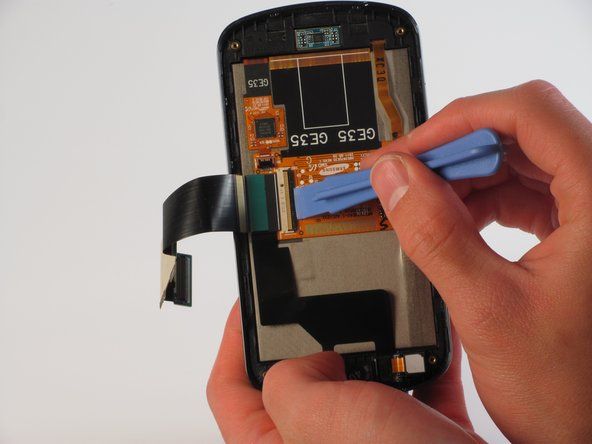 Use one of the plastic opening tools to loosen the flex cable from its central housing.