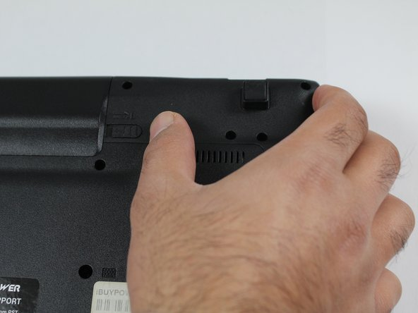 Push the right latch all the way to the right until it clicks into place.