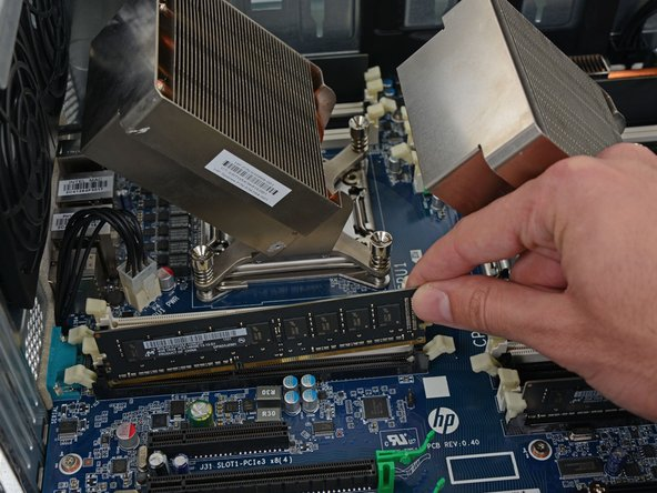 To get to the RAM, we had to open the case and remove the fan assembly—one more step than the Mac Pro, so we'll kick a point to Apple for being slightly easier in this respect.