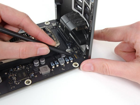 Set the assembly down on a flat surface to access the connectors on the IO board.