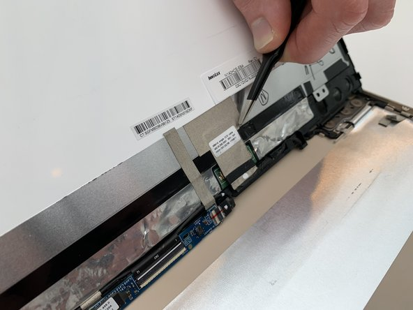 Using the Blunt Tweezers, remove the large piece of gray tape over the LCD Display connector.