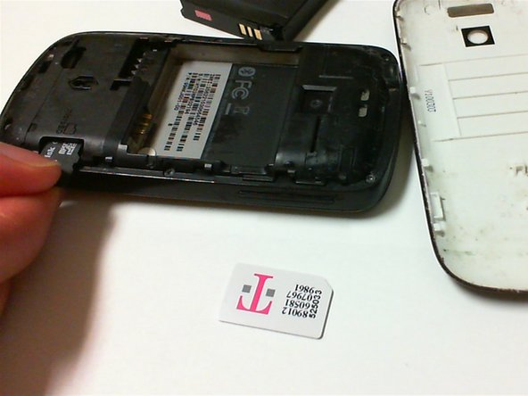 Push the SD card in and the SD card should pop loose.