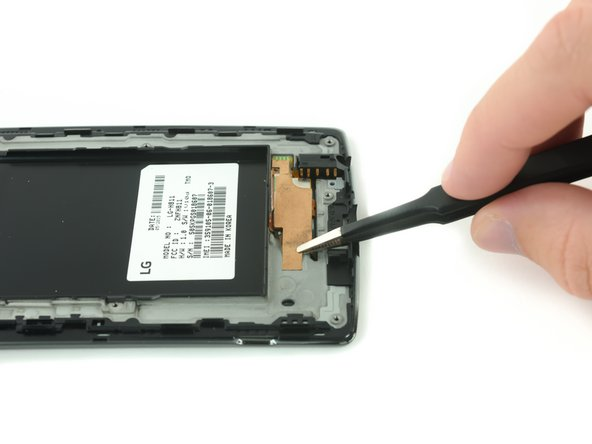 Use a pair of tweezers to remove the adhesive strip that secures the digitizer ribbon cable.