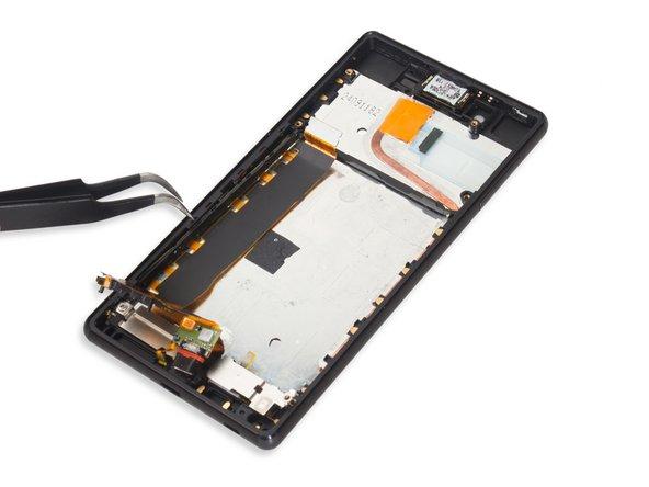 Remove USB charging flex assembly.