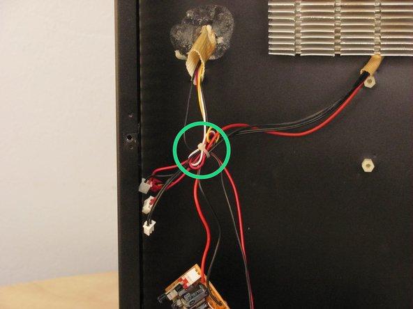 Cut zip tie binding wires together.