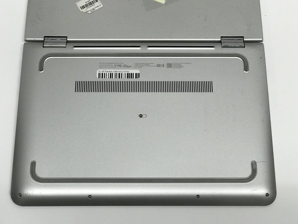 Flip the laptop over so that the bottom of the laptop is facing up.