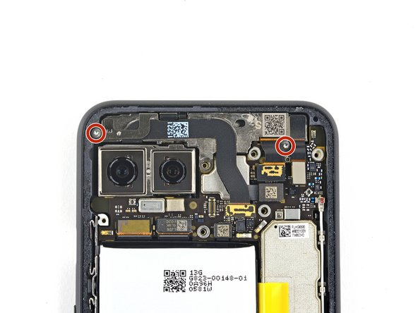 Use a T3 Torx driver to remove the two 2.4 mm screws securing the front camera and sensor assembly.