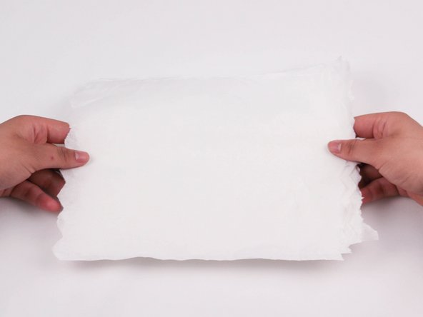 Place a few paper towels on the surface of your workspace to protect it from ink spills.