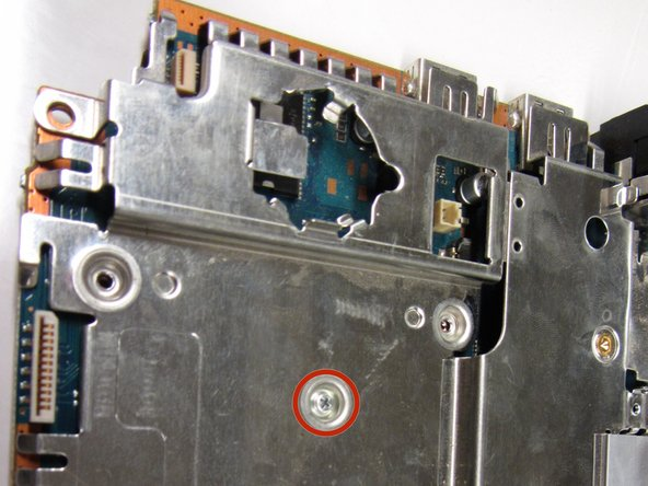 There are a total of five 1.6 mm screws which mount the metal chassis to the motherboard.