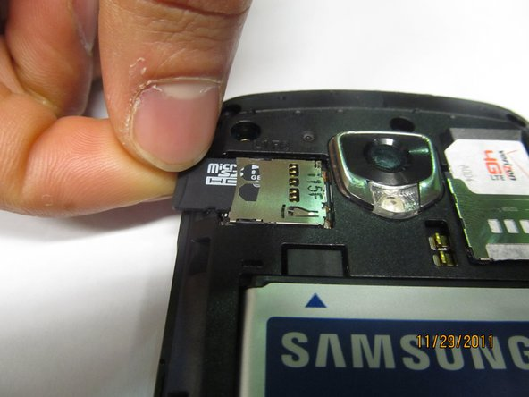 Push the SD card further into its metal slot until you hear a click.