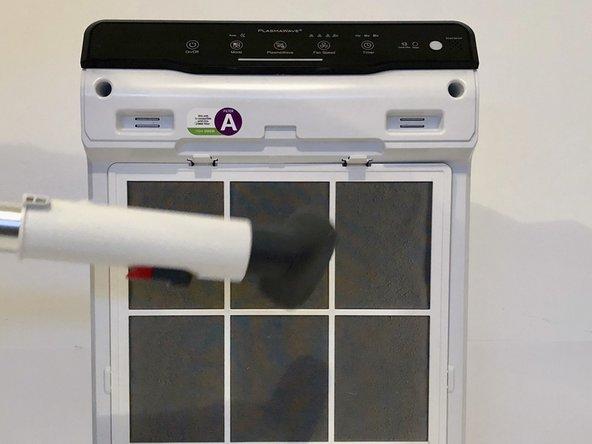 Using your vacuum, clean the air intake screen.