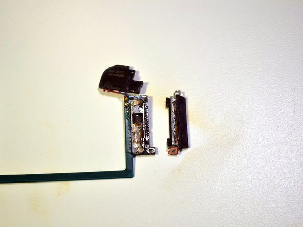 Once all solder is removed, pry the dock connector straight down from the logic board using a metal spudger.