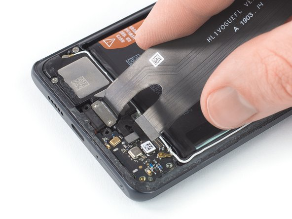 Remove the  main flex cable including the charging port by lifting it upwards and then pulling it in the direction of the motherboard.