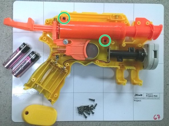 Remove the two phillips head, 8.2 mm screws holding the barrel in place.