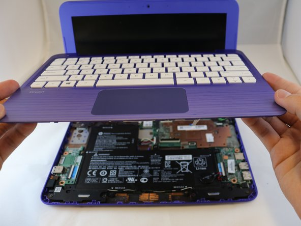 After detaching the two large ribbon cables, carefully lean the keyboard against the screen.