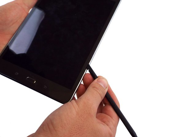 Use the spudger to separate the touch screen from the front cover of the device.