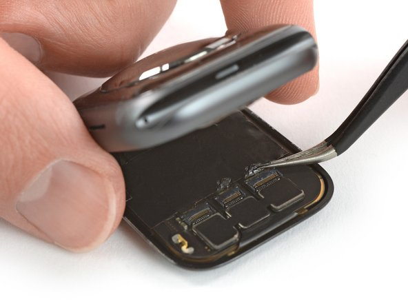 Use a pair of tweezers to carefully peel off the tape covering the three display cable connectors.