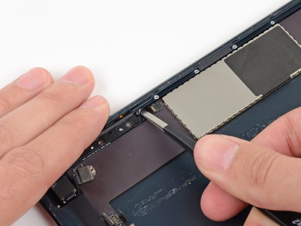Use tweezers to pull the button ribbon cable straight out of its ZIF socket on the logic board.