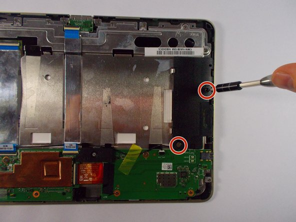 Use the +J000 screwdriver to remove screws four from speakers.