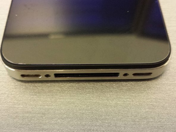 Carefully place the replacement panel on to the iPhone back lining it up as close to the bottom as possible.