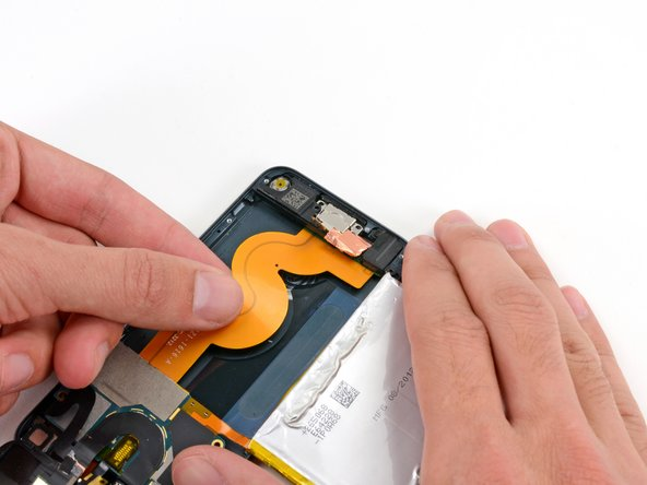 Grasping the large ribbon cable, gently pull the Lightning connector assembly out of the bottom of the case.