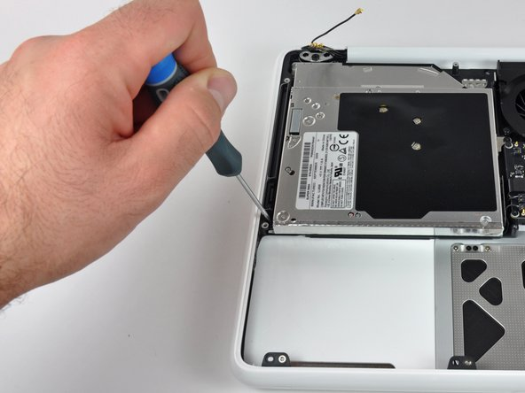 After removing the final few screws, lift the optical drive out of its comfy plastic unibody home.