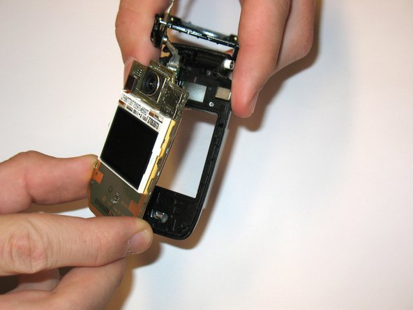 Pull out the circuit board, which will remove it completely from the case
