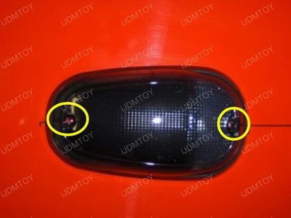 Use a screwdriver and attach the screws at the front and the rear of each LED roof lamp to permanently mount it.