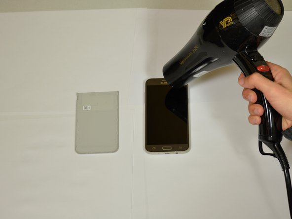Heat up the edges of the screen with a hair dryer.